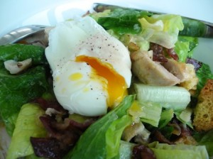 Grilled chicken caesar salad with poached egg