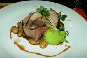 Roast leg of lamb with butter bean cassoulet and pea puree