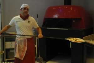 Raffaele baking pizza in Rosso Vivo's wood-fired oven