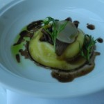 Rouille Raviolo of Organic Egg Yolk, Creamy Potato, Glazed Baby Onions, Irish Coolea Cheese, Mizuna
