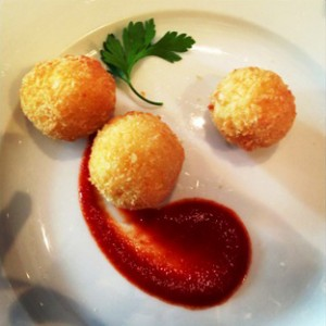 A Carluccio's dish for Taste of Dubai - crispy saffron risotto balls oozing with mozarella