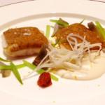 Sea bass fillet with liquorice crust on almond cream