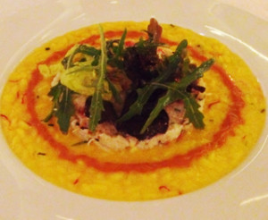 Saffron risotto topped with crabmeat salad and finished with sea urchin emulsion
